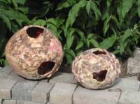 Outdoor candle holders with an organic finish on the outside